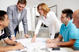 A group of project management experts in the planning phase